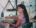 Working on opal designs at my jewelry bench 1983